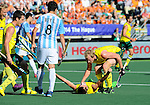 The Hague, Netherlands, June 13: Jacob Whetton #12 of Australia is congratulated by Aran Zalewski #17 of Australia during the field hockey semi-final match (Men) between Australia and Argentina on June 13, 2014 during the World Cup 2014 at Kyocera Stadium in The Hague, Netherlands. Final score 5-1 (3-0)  (Photo by Dirk Markgraf / www.265-images.com) *** Local caption *** Rey Lucas #8 of Argentina, Jacob Whetton #12 of Australia, Aran Zalewski #17 of Australia