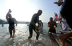 KAILUA-KONA, HI - OCTOBER 12:  Hines Ward heads in from the swim during the 2013 Ironman World Championship on October 12, 2013 in Kailua-Kona, Hawaii. (Photo by Donald Miralle) *** Local Caption ***