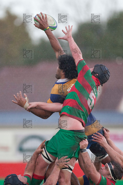 Alepini Olosoni beats Michael Baird to the ball at lineout time. Counties Manukau Premier Club Rugby Semi Final game between Waiuku and Patumahoe, played at Waiuku on Saturday June 25th 2011. Patumahoe won 23 - 14 and will meet Pukekohe in the McNamara Cup Premier final next week at Bayer Growers Stadium.