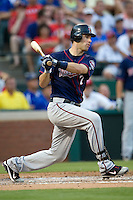 Minnesota Twins catcher Joe Mauer #7 follows through during a Major League Baseball game against the Texas Rangers at the Rangers Ballpark in Arlington, Texas on July 27, 2011. Minnesota defeated Texas 7-2.  (Andrew Woolley/Four Seam Images)