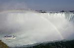 Niagara Falls, Ontario, Canada - 01 August 2006---The Niagara River falling horseshoe-wise / Horseshoe Falls with rainbow, the boat 'Maid of the Mist' cruises into the fall---nature, transport, tourism---Photo: © HorstWagner.eu