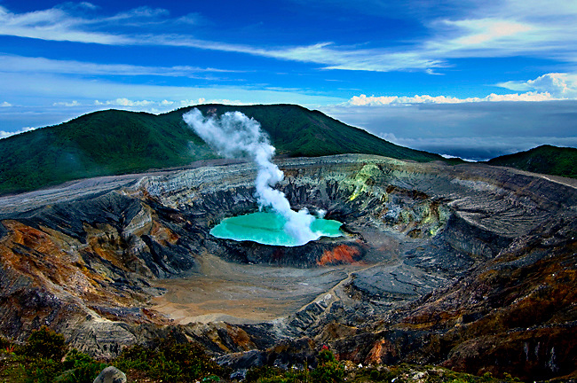 Steam And Gas Rise From The Sulfuric Tourquise Waters Of  Poas Volcano's Crater Lake, In Poas National Park, Costa Rica.