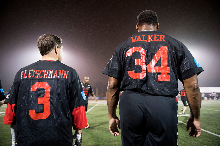 UNITED STATES - OCTOBER 11: Rep. Chuck Fleischmann, R-Tenn., and NFL star Herschel Walker watch amor the sidelines during the Congressional Football Game at Gallaudet University in Washington on Wednesday, Oct. 11, 2017. The game featured the Capitol Police team The Guards vs the Congressional team The Mean Machine. (Photo By Bill Clark/CQ Roll Call)