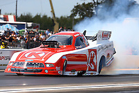 Aug. 18, 2013; Brainerd, MN, USA: NHRA funny car driver Tim Wilkerson during the Lucas Oil Nationals at Brainerd International Raceway. Mandatory Credit: Mark J. Rebilas-