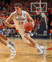 Virginia Cavaliers guard Joe Harris (12) handles the ball during the game against North Carolina in Charlottesville, Va. North Carolina defeated Virginia 54-51.