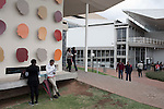 BLOEMFONTEIN, SOUTH AFRICA APRIL 17, 2013: Students outside lecture halls at the University of the Free State in Bloemfontein, South Africa. Races are mixing more but often they socialize with their own kind. Photo by: Per-Anders Pettersson