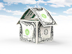 House made of money, thousand US dollar bills standing under blue sky isolated on white background. Property, real estate, housing concept.