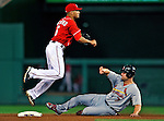 28 August 2010: Washington Nationals infielder Ian Desmond turns a double-play in the 8th inning against the St. Louis Cardinals at Nationals Park in Washington, DC. The Nationals defeated the Cards 14-5 to take the third game of their 4-game series. Mandatory Credit: Ed Wolfstein Photo
