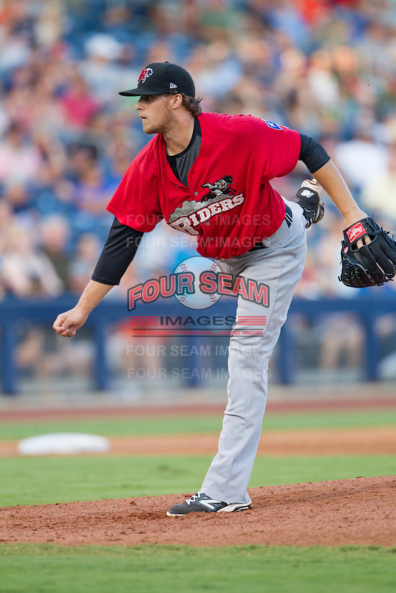 Frisco RoughRiders pitcher Jake Thompson (29) pitches during the Texas League game against the Tulsa Drillers at ONEOK field on August 15, 2014 in Tulsa, Oklahoma  The RoughRiders defeated the Drillers 8-2.  (William Purnell/Four Seam Images)