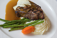 Beed Tenderloin with potatoes, green beans. and a piece of carrot