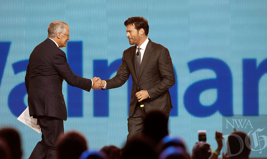 NWA Media/JASON IVESTER --06/06/2014--<br /> Rob Walton, chairman of the board, greets celebrity emcee Harry Connick, Jr., on stage on Friday, June 6, 2014, during the annual Shareholders Meeting inside Bud Walton Arena in Fayetteville.