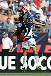 11 July 2009: New England's Emmanuel Osei (5) and Kansas City's Josh Wolff (behind). The New England Revolution played the Kansas City Wizards at Gillette Stadium in Foxboro, Massachusetts in a regular season Major League Soccer game.