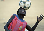 A boy heads a soccer ball during a football game in Agok, a town in the contested Abyei region where tens of thousands of people fled in 2011 after an attack by soldiers and militias from the northern Republic of Sudan on most parts of Abyei. Although the 2005 Comprehensive Peace Agreement called for residents of Abyei--which sits on the border between Sudan and South Sudan--to hold a referendum on whether they wanted to align with the north or the newly independent South Sudan, the government in Khartoum and northern-backed Misseriya nomads, excluded from voting as they only live part of the year in Abyei, blocked the vote and attacked the majority Dinka Ngok population. The African Union has proposed a new peace plan, including a referendum to be held in October 2013, but it has been rejected by the Misseriya and Khartoum. The Catholic parish of Abyei, with support from Caritas South Sudan and other international church partners, has maintained its pastoral presence among the displaced and assisted them with food, shelter, and other relief supplies.