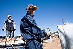 Césaraldo Villalobo, a volunteer with the Migrant Resource Center, fills a water tank in the desert near Naco, Sonora, Mexico, on Wednesday, Jan. 30, 2008. MRC is a bi-national project of Citizens for Border Solutions (Bisbee, AZ) and Iglesia del Camino (Naco, Mexico), with support of other organizations and individuals. In back is Esteban Perez.