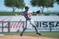 Salt River Rafters shortstop Carter Kieboom (24), of the Washington Nationals organization, throws to first base during an Arizona Fall League game against the Surprise Saguaros on October 9, 2018 at Surprise Stadium in Surprise, Arizona. The Rafters defeated the Saguaros 10-8. (Zachary Lucy/Four Seam Images)