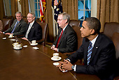United States President George W. Bush chairs a meeting on the state of the economy in the Cabinet Room of the White House in Washington, DC on September 25, 2008. Pictured, from left to right: President Bush; US Senate Majority Leader Harry Reid (Democrat of Nevada); US Senate Minority Leader Mitch McConnell (Republican of Kentucky), and US Senator Barack Obama (Democrat of Illinois), the Democratic Party nominee for President of the US.<br /> Credit: Kristoffer Tripplaar / Pool via CNP