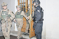 Military and police leave the NH State House before Vice President Mike Pence  leaves the New Hampshire Secretary of State's office in the New Hampshire State House in Concord, New Hampshire, on Thu., November 7, 2019. Pence traveled to New Hampshire as a surrogate for Donald Trump to file required paperwork for the president to get on the New Hampshire presidential primary ballot in 2020. The required documents include a filing form signed by the candidate and a $1000 filing fee.