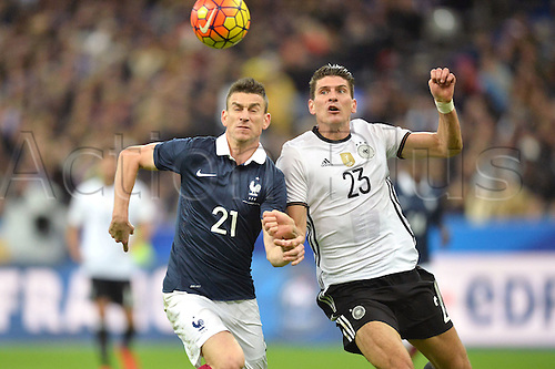 13.11.2015. Stade de France, Paris, France. International football friendly. France versus Germany.  Mario GOMEZ - Laurent Koscielny . The game was parially interupted as the paris terror attacks took place and bombs were heard going off outside the stadium.