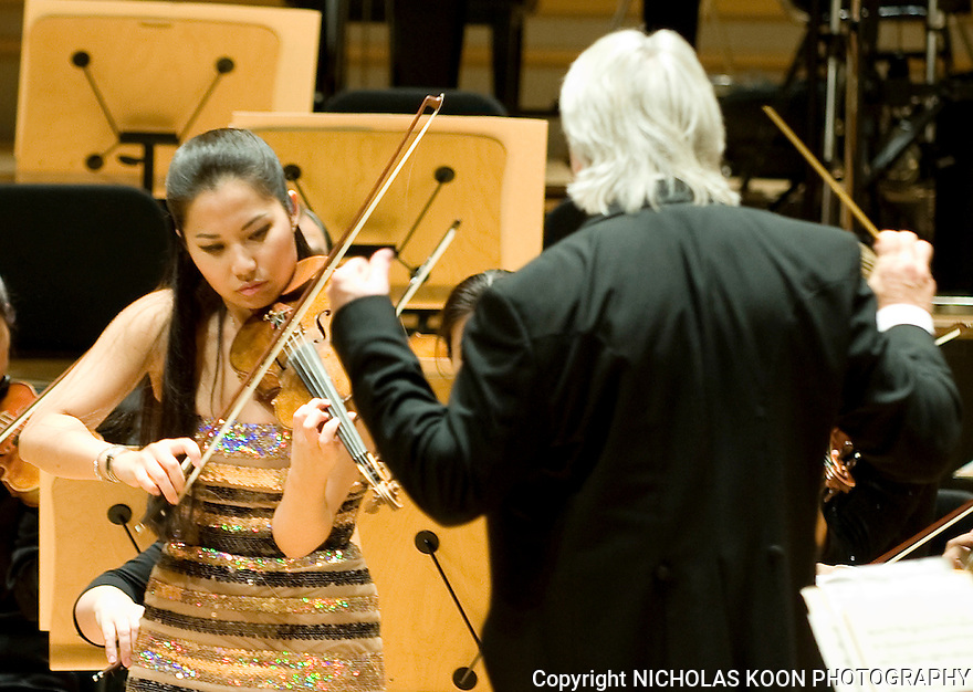 Violinist Sarah Chang concentrates as she plays Felix Mendelssohn's Concerto in E Minor for Violin and Orchestra (Op.64) with Conductor Carl St. Clair and the Pacific Symphony.   This was the season openign concert for the Pacific Symphony at the Rene and Henry Segerstrom Concert hall.