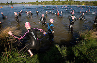 10 MAY 2009 - GRENDON,GBR - A competitor enters the water in  preparation for the start of the female competitors wave - Grendon Triathlon (PHOTO (C) NIGEL FARROW)