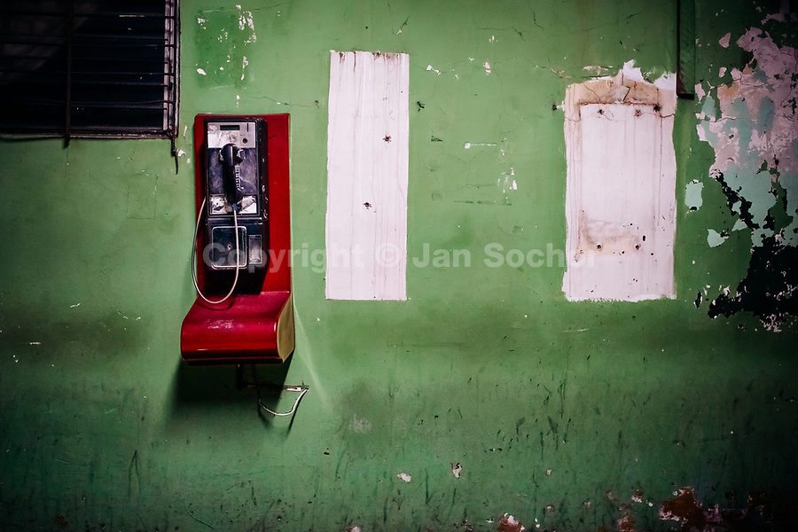 A public pay phone is seen hung on the wall in a patio inside the emergency department of a public hospital in San Salvador, El Salvador, 16 December 2015.