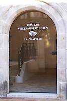 La Chapelle, the Chapel, converted to a tasting room. Chateau Villerambert-Julien near Caunes-Minervois. Minervois. Languedoc. A door. The wine shop and tasting room. France. Europe.