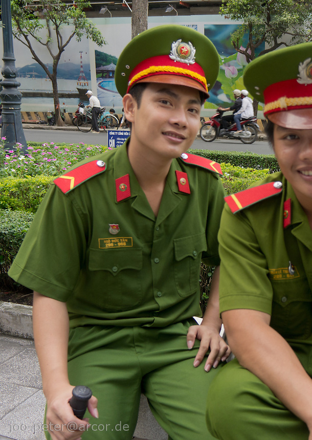 soldiers or police man in communist uniform relaxing in the centre of Ho Chi Minh City / Saigon,  Vietnam