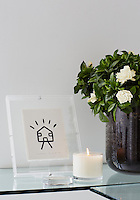 A potted Gardenia and a scented candle fill the home office with a heady aroma