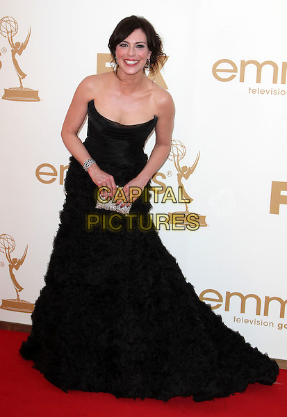 Michelle Forbes.63rd Primetime Emmy Awards - Arrivals Held at The Nokia LA Live, Los Angeles, California, USA..September 18th, 2011.full length black strapless dress smiling bending leaning silver clutch bag frills emmys.CAP/ADM/KB.©Kevan Brooks/AdMedia/Capital Pictures.