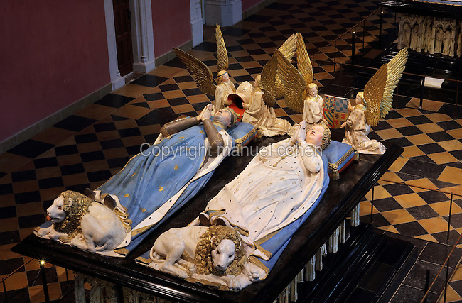 Tomb of Jean sans Peur, or John the Fearless, 1371-1419, (Jean de Valois or John of Valois, Jean I, duc de Bourgogne, or John I, Duke of Burgundy) and his wife Marguerite de Baviere, or Margaret of Bavaria, 1363- 1423, 1443-70, by Jean de la Huerta, 1413-62, and Antoine le Moiturier, 1425-97, in the Grande Salle du Palais des ducs de Bourgogne, or Salle des Gardes, a 15th century Flamboyant Gothic hall, in the Musee des Beaux-Arts de Dijon, opened 1787 in the Palace of the Dukes of Burgundy in Dijon, Burgundy, France. The tomb consists of painted alabaster effigies with lions and angels, and below, figures of pleurants or weepers among Gothic tracery. The tomb was begun in 1443 (24 years after his death), by Jean de La Huerta, and Antoine le Moiturier after 1456, and finally installed in 1470. The tombs were originally from the Chartreuse de Champmol, or Chartreuse de la Sainte-Trinite de Champmol, a Carthusian monastery which was sacked in the French Revolution and the tombs moved to Dijon cathedral then here in 1827. The effigies are 19th century reconstructions, the originals being destroyed in the French Revolution. Picture by Manuel Cohen