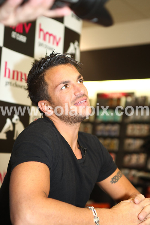 **ALL ROUND PICTURES FROM SOLARPIX.COM**.**WORLDWIDE SYNDICATION RIGHTS**.Australian pop singer and ex husband of katie Price signing his new album ay HMV music store in Cardiff in wales in the Uk today..This pic:Peter Andre..JOB REF:9973       NYA     DATE:18.09.09.**ALL ROUND EXCLUSIVE PICTURES FROM SOLARPIX.COM