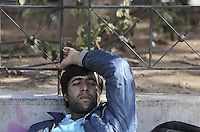 Pictured: A male migrant rests on a bench at Victoria Square Tuesday 23 February 2016<br /> Re: Refugees at Victoria Square in the centre of Athens, Greece