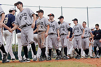 Edgewood Eagles shake hands with Bethel Wildcats after the second game of a double header on March 15, 2019 at Terry Park in Fort Myers, Florida.  Bethel defeated Edgewood 3-2.  Shown are Richie Coughlin (31), Ryan Fields (9), Ryan Cassady (5), Eric Nelson (19), Ryan Gale (14), and Dane Lamont (17).  (Mike Janes/Four Seam Images)