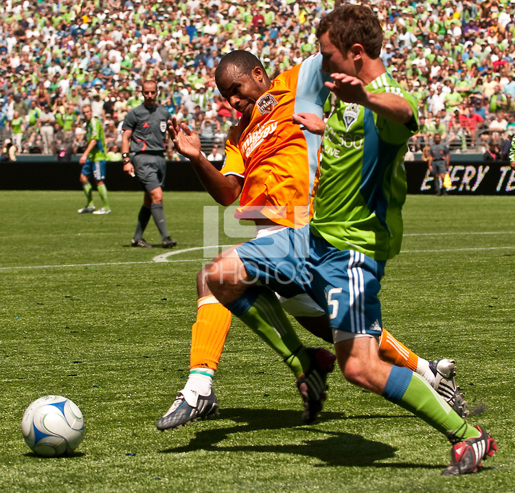 Stephen King (l) of the Seattle Sounders and Ricardo Clark (r) of the Houston Dynamos fight for the ball in the match at the XBox Pitch at Quest Field on July 11, 2009. The Sounders defeated the Dynamo 2-1.