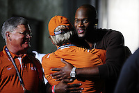 Jan 7, 2010; Pasadena, CA, USA; Tennessee Titans quarterback Vince Young (right) hugs a member of the Texas Longhorns coaching staff before the 2010 BCS national championship game against the Alabama Crimson Tide at the Rose Bowl.  Mandatory Credit: Mark J. Rebilas-