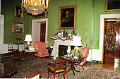 """This is the Green Room, one of the three Parlors on the State Floor of the White House in Washington, D.C. on December 6, 1999.  The renowned portrait of Benjamin Franklin by David Martin is in the top center of the photo.  The vignette on the Green Room's mantel showcases projects of """"Save America's Treasures"""" that are being preserved as part of today's national landscape..Credit: Ron Sachs / CNP"""