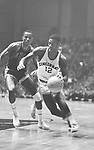 11 MAR 1960:  Oscar Robertson (12) of Cincinnati and unidentified player from DePaul during the 1960 NCAA Men's Basketball Midwest Regional Semifinal game in Manhattan, KS. Cincinnati defeated DePaul 99-59. Cincinnati lost to California in the National Semifinals 77-69 in San Francisco. Photo Copyright Rich Clarkson.