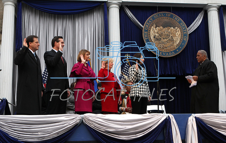 Nevada Chief Supreme Court Justice Michael Douglas, right, administers the oath of office to Constitutional officers, from left, Lt. Gov. Brian Krolicki, Secretary of State Ross Miller, Treasurer Kate Marshall, Controller Kim Wallin and Attorney General Catherine Cortez Masto during Monday's inauguration, Jan. 3, 2011 at the Capitol in Carson City, Nev.<br /> Photo by Cathleen Allison