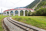 The Brusio spiral viaduct is a single-track nine-arched stone spiral railway viaduct.  A signature structure of the World Heritage-listed Bernina railway, it is located near Brusio, in the Canton of Graubünden, Switzerland, and was built to limit the railway's gradient at that location within its specified maximum of 7%. The Brusio spiral viaduct forms part of the Bernina Railway section between Brusio and Campascio. It is just south of Brusio, and approximately 54 kilometres (34 mi) from St. Moritz.