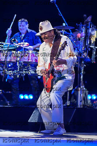 Carlos Santana - performing live at the LG Arena in Birmingham UK - 17 Jul 2013.  Photo credit: Tony Woolliscroft/IconicPix