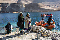 Amina and her colleagues are cleaning the approach of the lake while their supervisor (on the right) cleans the water on the pedalo,Band-e Amir, Afghanistan, 8th November 2017.<br /> <br /> Amina et ses collègues nettoient le bord du lac tandis que leur patron nettoie les abords du lac à bord d'un pédalo, Band-e Amir, Afghanistan, 8th November 2017.