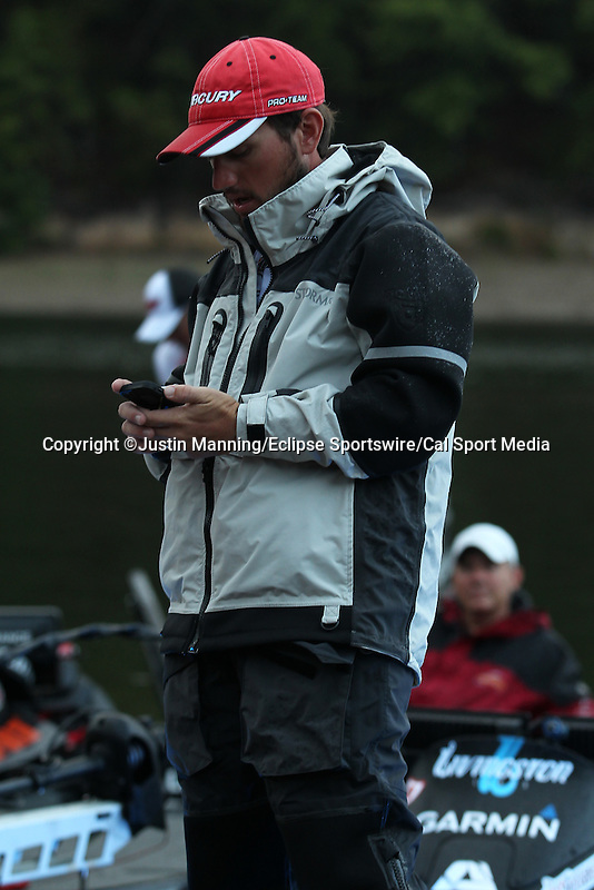 August 22, 2015: Stetson Blaylock checking his phone before the start of day three of the Forrest Wood Cup on Lake Ouachita in Hot Springs, AR. Justin Manning/ESW/CSM