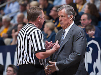 Mike Montgomery of California listens to referee during a game against Washington State at Haas Pavilion in Berkeley, California on January 5th, 2014. California defeated Washington State 76 - 55