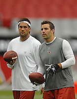 Aug 18, 2007; Glendale, AZ, USA; Arizona Cardinals quarterback (7) Matt Leinart and quarterback (13) Kurt Warner warm up prior to the game against the Houston Texans at University of Phoenix Stadium. Mandatory Credit: Mark J. Rebilas-US PRESSWIRE Copyright © 2007 Mark J. Rebilas