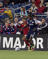 Real Salt Lake midfielder Arturo Alvarez (10) and New England Revolution midfielder Shalrie Joseph (21) battle for the ball. In a Major League Soccer (MLS) match, Real Salt Lake defeated the New England Revolution, 2-0, at Gillette Stadium on April 9, 2011.