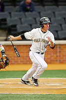 Andrew Williams (16) of the Wake Forest Demon Deacons follows through on his swing against the Western Carolina Catamounts at Wake Forest Baseball Park on March 26, 2013 in Winston-Salem, North Carolina.  The Demon Deacons defeated the Catamounts 3-1.  (Brian Westerholt/Four Seam Images)