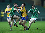 Alan Sweeney of Clare  in action against Jack Ryan and Hugh Burke of Limerick during the Mc Nulty Cup U-21 final at The Gaelic Grounds. Photograph by John Kelly.