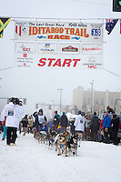 Karin Hendrickson and team leave the ceremonial start line at 4th Avenue and D street in downtown Anchorage during the 2013 Iditarod race. Photo by Jim R. Kohl/IditarodPhotos.com
