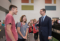 NWA Democrat-Gazette/BEN GOFF @NWABENGOFF<br /> Jeff Wassem (right), principal of Creekside Middle School, talks to guests Friday, Aug. 11, 2017, during a grand opening for Osage Creek Elementary School and Creekside Middle School in Bentonville. The new schools will welcome their first students Monday.