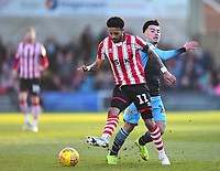 Lincoln City's Bruno Andrade vies for possession with Stevenage's Ilias Chair<br /> <br /> Photographer Andrew Vaughan/CameraSport<br /> <br /> The EFL Sky Bet League Two - Lincoln City v Stevenage - Saturday 16th February 2019 - Sincil Bank - Lincoln<br /> <br /> World Copyright © 2019 CameraSport. All rights reserved. 43 Linden Ave. Countesthorpe. Leicester. England. LE8 5PG - Tel: +44 (0) 116 277 4147 - admin@camerasport.com - www.camerasport.com